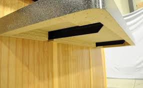 underneath a floating shelf showcasing two extended concealed brackets