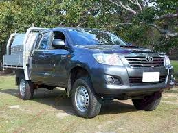 lifted toyota hilux. front view of a grey toyota hilux dual cab with aluminium tray fitted lifted