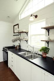 kitchen sconce lighting. Kitchen, Single Wall Sconce Light Fixture Some Floating Wood Shelves Black Kitchen Counter Double Stainless Steel Sink And Faucet White Base Cabinets Lighting