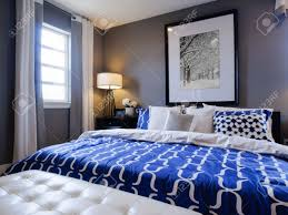 Modern Blue Bedroom Modern Master Bedroom With Blue Wall And White Linens Stock Photo