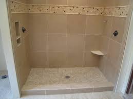 this custom tile bathroom installation uses ceramic tile on the walls and floor the custom shower pan is made up 1x1 tile mat pieces to give it a nice