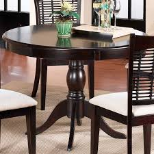 featuring a pedestal base and a rich cherry finish this versatile wood dining table brims with timeless appeal dining table construction