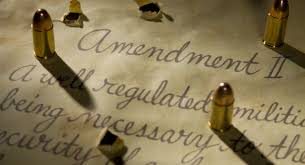 missourians approve measure strengthening second amendment second amendment bullets casting shadows onto the document