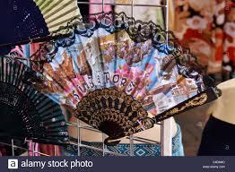 fan on sale. colorful ladies hand fan on sale in chinatown market, singapore.