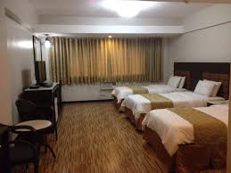 this room is available in two set ups the first is furnished with three single beds while the other has one queen size bed and one single bed