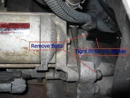 how to remove install a starter fix a clicking starter 2 7 liter the top bolt has a wire connected to it make sure you reconnect this wire when you are reinstalling the starter