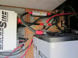 2014 rv get fit com here you can see where i added the 400 amp t fuse cover yellow triangle and over to the right just above the batteries is the 500 amp shunt for the