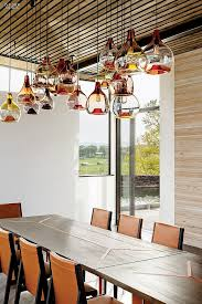 view in gallery water drop pendants in handblown glass by esque studio