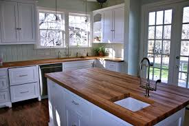 oak wood for furniture. Reclaimed Oak Wood Countertops For White Kitchen Island Having Square Undermount Sink Placed On Brown Flooring Furniture O
