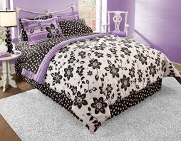 white black bedding set with fl patterns combined with stripped purple pattern placed on the white steel bed