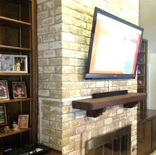 mounting tv in brick fireplace mounting into brick fireplace above best hide ideas barn door built