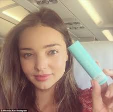 fresh faced with minimal make up miranda kerr pictured reveals that a green
