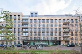 Mecanoo's massive brick-clad De Halve Maen apartment building in Amsterdam  features very tiny, tenuous but elegant details to relieve the structure on  the ...