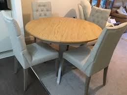 nearly new marks and spencer padstow extending round table oak and cream colour plus 4