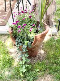 Repurposed chiminea into a flower pot.