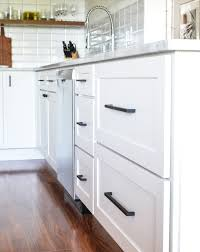matte black cabinet pulls on white cabinets. another touch of black is found in these top knobs noveau iii pulls and matte black. i love the clean lines shaker style drawer fronts cabinet on white cabinets h
