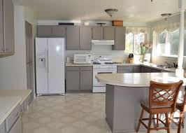 enchanting grey kitchen cabinets with white countertops and woodne chair