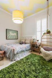 playful kids bedroom with chevron ceiling and birdcage chair
