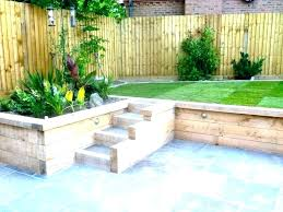 backyard retaining wall cost to build a on sloped retai