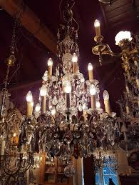 large chandelier with colored crystals like purple and amber beautiful glass in the centre