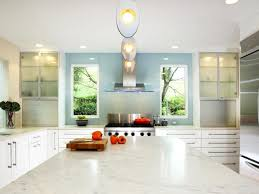 contemporary white kitchen with blue focal wall