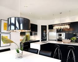 lighting over a kitchen island. example of a trendy eatin kitchen design in other with stainless steel appliances lighting over island h