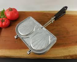 sefama shell sandwich maker aluminum panini press a sandwich maker or panini press molded shell shaped aluminum pockets sefama