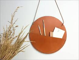 javier prieto martínez of miolos design has created a collection of leather pockets that hang