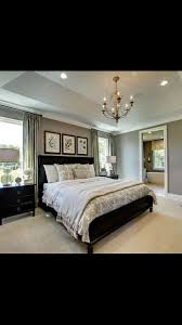 Best  Bed Between Windows Ideas On Pinterest - Master bedroom window treatments