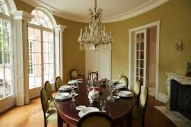 the schulzes had a local artisan custom build their dining table the antique chandelier