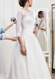 bride in alterations having sleeves added to wedding gown