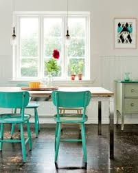paradise blue kitchen chairs with modern chrome and wood table weathered wood floors and sunlight i d add a few more modern elements to keep the look from