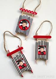Ornament activities: Christmas crafts for kids: Popsicle Stick Sled  Ornament with photos.