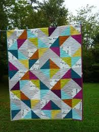 the Turning Twenty quilt using 20 fat quarters -- can't wait to do ... & It's Friday and I have a finish hot out of the dryer! Last night I finished  off the binding on my Charity Quilt for The Lodge that Gives , Adamdwight.com