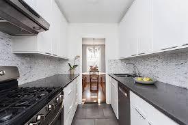 white kitchen dark tile floors. Wonderful White Small White Galley Kitchen With Black Corian Countertops And Mosaic Tile  Backsplash With White Kitchen Dark Tile Floors