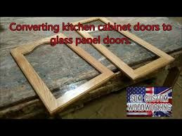 giving kitchen cabinet doors a new look by changing them to glass doors