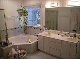 bathroom vintage bathroom lighting ideas brown brazilian cherry wood flooring clear glass shower bath freestanding