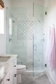 glass walk in shower with marble quatrefoil accent tiles