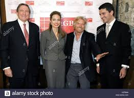 l r global business coalition on hiv aids president and ceo l r global business coalition on hiv aids president and ceo richard holbrooke actress angelina jolie chairman of virgin group sir richard branson and