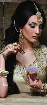 regal gold south asian bridal look her maang tikka and panja are so
