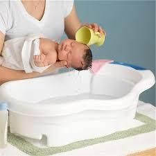 mother washing newborn baby stock photo premium royalty free code 600