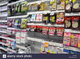 artifical stock photos artifical stock images alamy miami beach florida walgreens shopping retail display competing brands for shelves packaging cosmetics accessories
