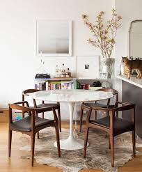 tulip table and pretty mid century chairs lovely except the skin on the floor sorry just can t go there it s creepy to me and gross when your food
