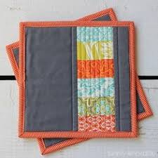 This quilted potholder tutorial uses stacked coins to create ... & Modern Quilted Potholder Adamdwight.com