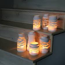 cute yarn wrapped painted solar light jars diy from the forge