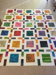 My most RePinned of all my fabric-related pins. I love the pattern ... & Framed quilt by Camille Roskelley done in batiks. Great Square Quilt Blocks  to show off Fantastic Fabrics Adamdwight.com