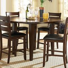 round brown wood bar height dining table set with
