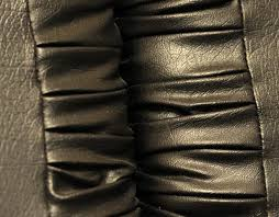 black cowhide leather is used to upholster furniture