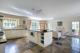 slate floor kitchen. Dazzling Le Creuset Dutch Oven In Kitchen Farmhouse With Off White Next To Slate Floor Alongside Cabinets And Built Microwave T