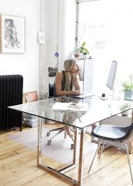 in home office. Campanaro Works From A Glass-topped Dining Table CB2. In Home Office